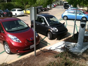 A Nissan Leaf and Smart E Car recharge at a Level 2 ChargePoint station